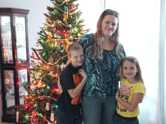 Cathy Hodges works two jobs to support her two children, Testa Greer, 7, and Michael Jackson, 11.
