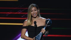Olympic snowboarder Chloe Kim accepts the award for