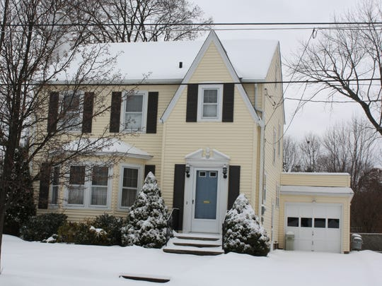 A house on Vermont Avenue in Binghamton was blanketed in snow Saturday morning.