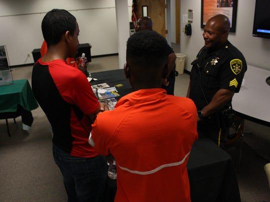 School Resource Officer Art Williams speaks to members