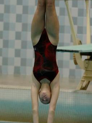 Neenah's Bailey Schroeder completes her dive during