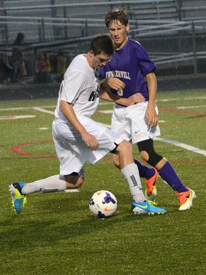 Fowlerville's Bailey Edwards (right) had two assists, including a key one on Cory LeMieux's first of three goals in a 5-0 win at Corunna.