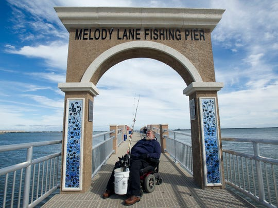 Charlie Childs, of Fort Pierce, fished off the Melody Lane Fishing Pier for the first time Tuesday, Jan. 19, 2016, in Fort Pierce.