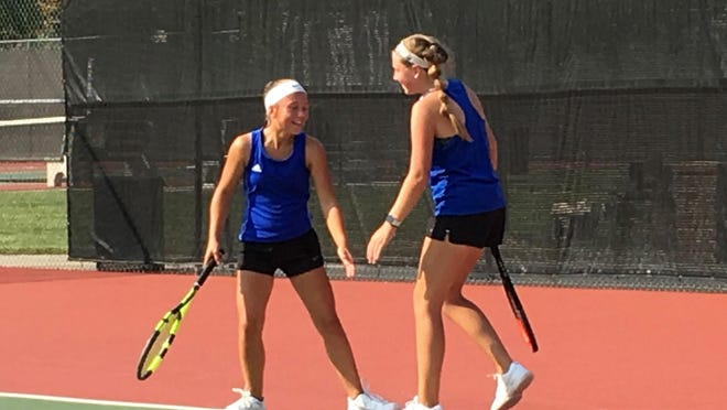 Washburn Rural Class 6A regional doubles champions Meredith Kucera, left, and Kate Fritz celebrate a point during Friday's regional tennis tournament at Kossover Tennis Center.