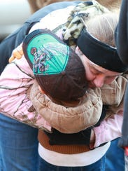 Elizabeth Carr, owner of the Camp Union Saloon, gets a hug from Joie Dlugosh, 4, after she visited with Santa and got a present outside of the Camp Union Saloon.
