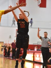 McAuley's Lexi Fleming puts up a 3 point shot against