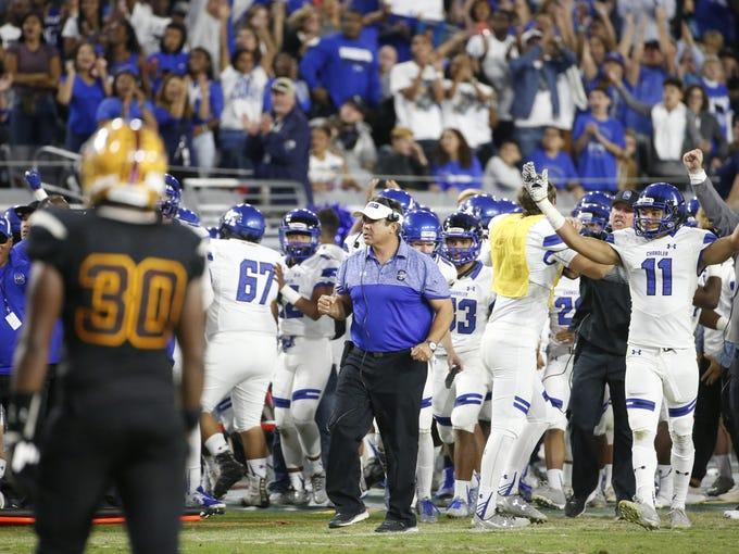 Chandler head coach Shaun Aguano celebrates a touchdown