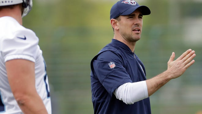 Tennessee Titans new offensive coordinator Matt LaFleur, right, explains a play during a voluntary practice at the team's NFL football training facility Wednesday, April 25, 2018, in Nashville, Tenn. (AP Photo/Mark Humphrey) ORG XMIT: TNMH118