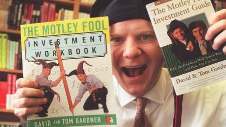 Tom Gardner is shown here with copies of two of the Motley Fool investment books he and his brother, David , have produced.