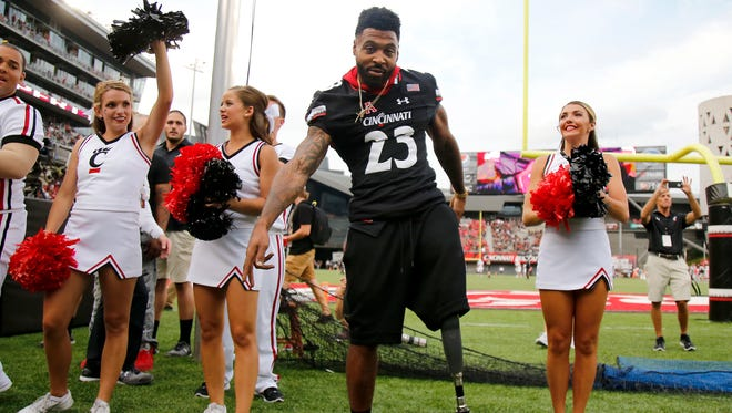 """Former Cincinnati Bearcats running back Isaiah Pead leads the student section in """"Down the Drive"""" before the college football game between the Austin Peay Governors and the Cincinnati Bearcats on Aug. 31 at Nippert Stadium."""