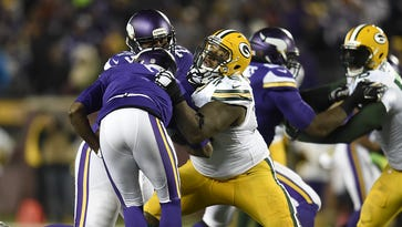 Green Bay Packers defensive end Mike Daniels (76) pressures quarterback Alex Smith (11) against the Kansas City Chiefs at Lambeau Field.