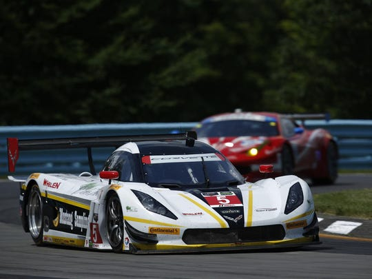The Action Express Corvette DP of Joao Barbosa and Christian Fittipaldi competing during the 2015 Sahlen's Six Hours of The Glen.