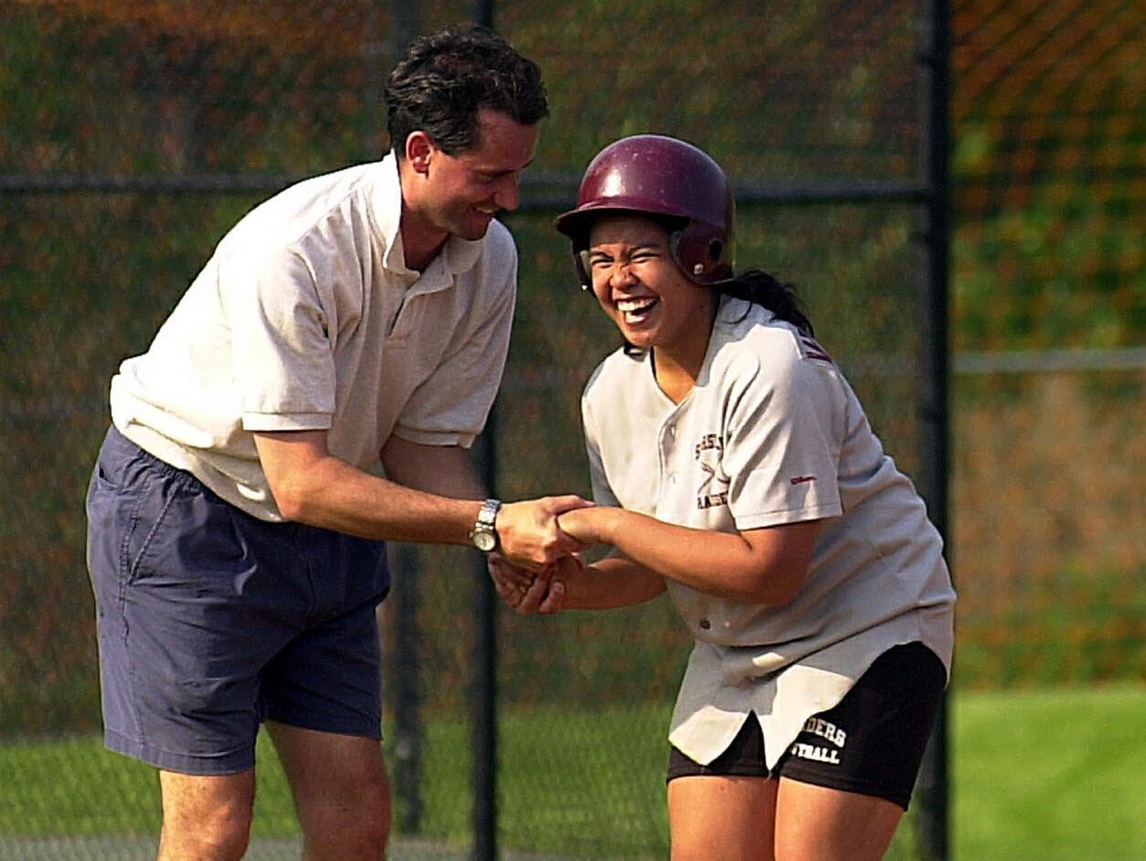 Former Scarsdale softball coach David Scagnelli congratulates Denise Villaneuva at third base during a game against Ursuline on May 9, 2000. Scagnelli will not return as head softball coach at Scarsdale next year.