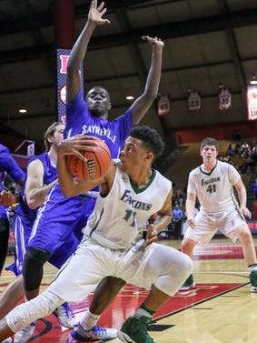 St. Joseph's Letrell West (11) tries to get around the Sayreville defense during the GMC Tournament final on Feb. 24, 2017.
