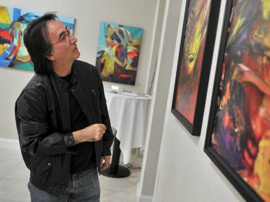 Ricardo Perez Messina looks at his work during a 2012