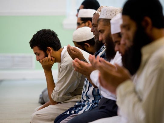 Area Muslims pray June 13, 2016 at the Islamic Center of Fort Pierce on West Midway Road in Fort Pierce.