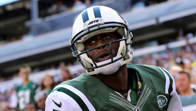 New York Jets quarterback Geno Smith (7) reacts on the field against the Detroit Lions during the second half at MetLife Stadium.