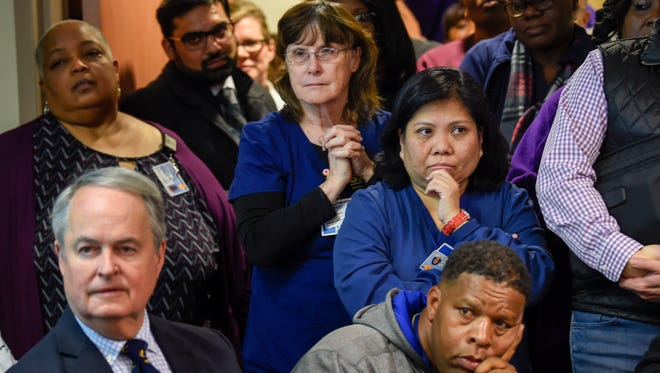 Members of the community listen as people express their opinions about the possible end of in-patient services at Nashville General to the Hospital Authority Board during a meeting at Nashville General Hospital  in Nashville, Tenn., Friday, Nov. 17, 2017.