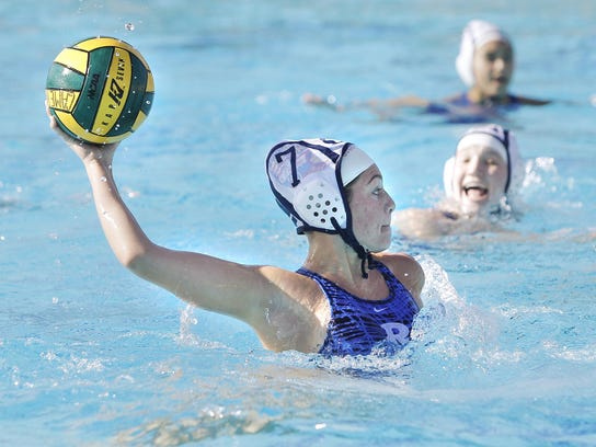 Redwood's Emma Peters winds back and fires against