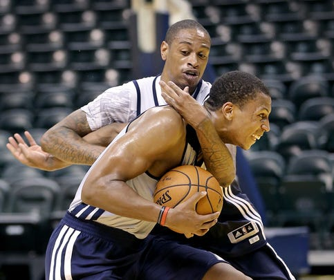 Pat Connaughton,left, from Notre Dame, drives on Jabril Trawick, from Georgetown, during their rookie workout for the Pacers Tuesday, May 26, 2015, afternoon at Bankers Life Fieldhouse.