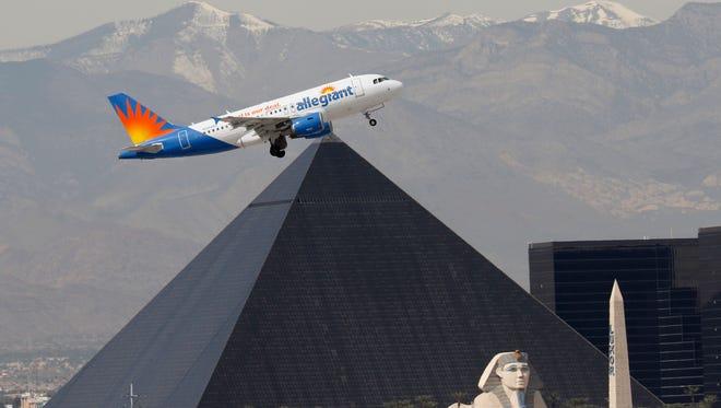 An Airbus A319 jetliner, belonging to Allegiant Air, takes off at McCarran International Airport in Las Vegas, Nevada on Mar. 3, 2016. Behind it is the Luxor Hotel/Casino.   (Larry MacDougal via AP)