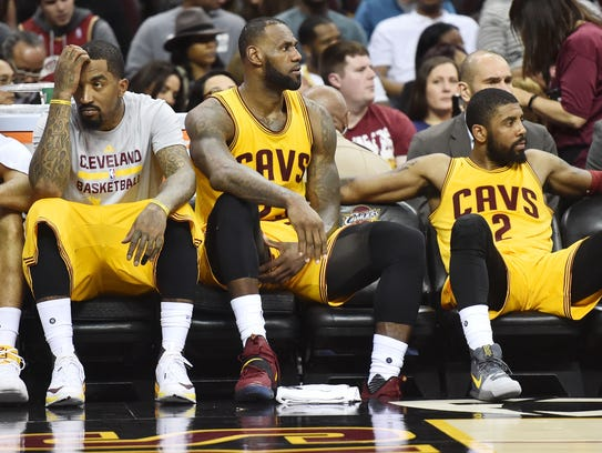 JR Smith (5), LeBron James (23) and Kyrie Irving (2)