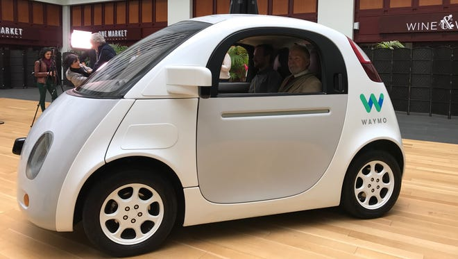 Waymo, the newly renamed Google self-driving car company, showed off its two seat prototype and new logo in the lobby of a San Francisco building Tuesday.