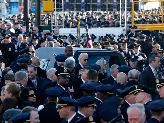 U.S. Vice President Joe Biden, center, arrives for funeral services for New York City police officer Rafael Ramos at Christ Tabernacle Church in Queens, New York, Saturday, Dec. 27, 2014.
