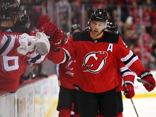 New Jersey Devils left wing Taylor Hall (9) celebrates his goal during the first period of their game against the Los Angeles Kings at Prudential Center.