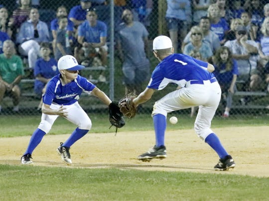 Horseheads second baseman Lucas Granger, left, and shortstop Matt Procopio converge on a grounder up the middle that was fielded by Granger in Horseheads' 4-3 win over Fayetteville-Manlius in the Section 1 East Little League 10-12 Tournament at Horseheads.