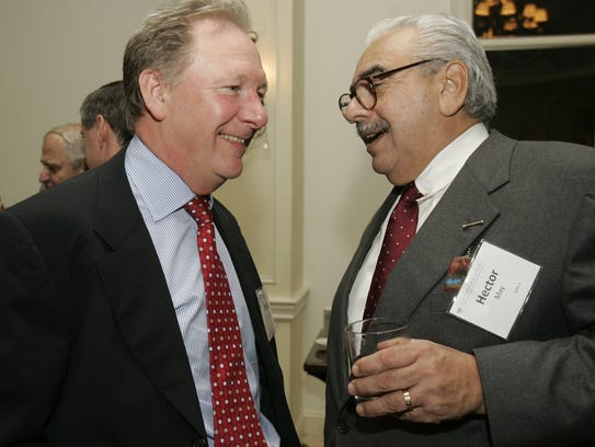 Michael Pointing, left, former general manager and