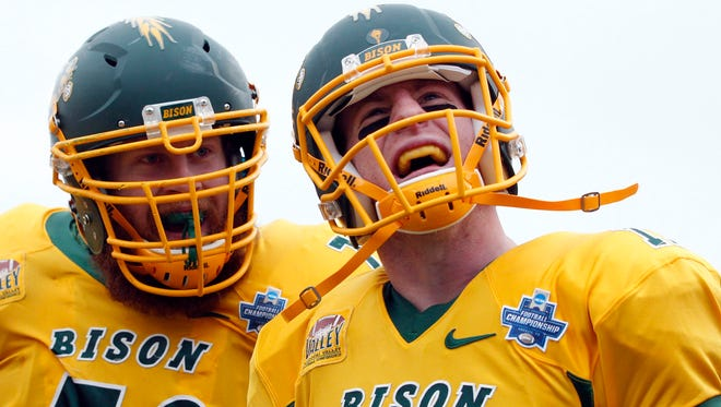 QB Carson Wentz (11) led North Dakota State to two FCS titles.