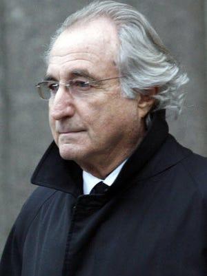 File photo shows Ponzi scheme architect Bernard Madoff leaving federal court in 2009