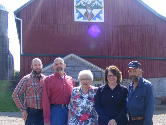 636413499117490208-Buck-Family-with-Barn-Quilt.jpg