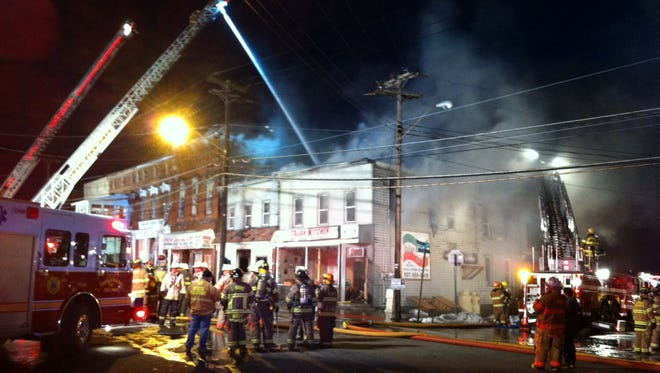 Firefighters on the scene of a massive fire Tuesday evening in the Village of Ovid, Seneca County.