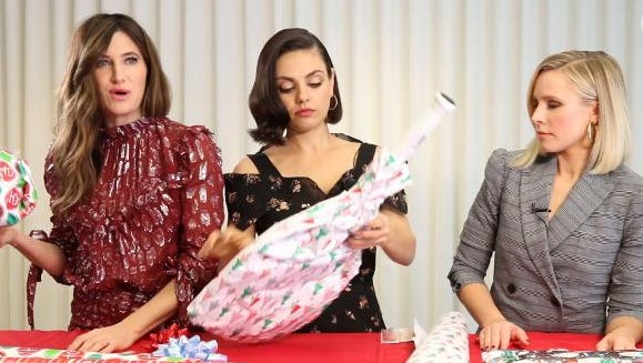 Kathryn Hahn, Mila Kunis and Kristen Bell wrap awkward presents for 'A Bad Moms Christmas.'
