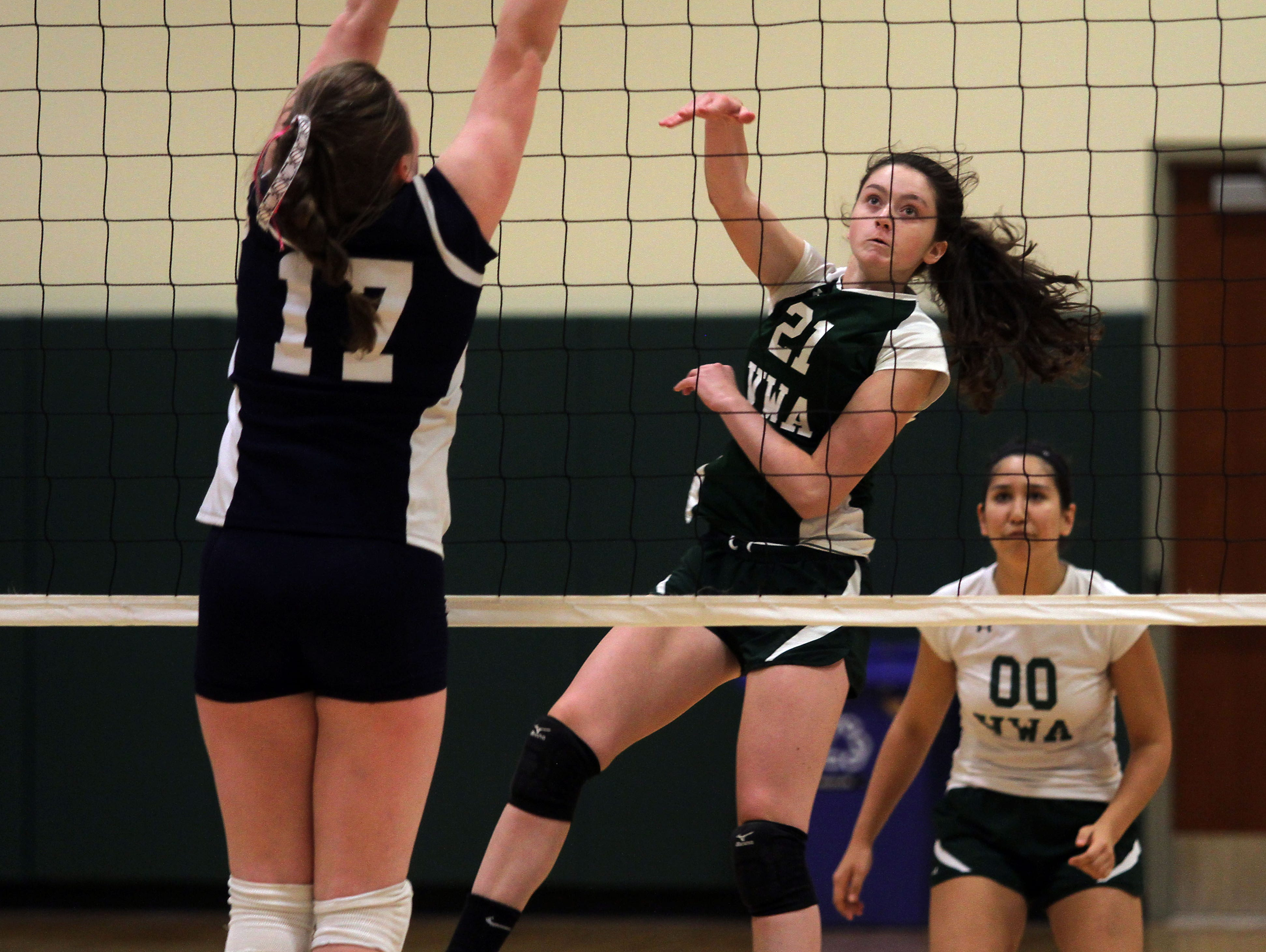 Villa Walsh's Maggie Pietrucha hits a kills vs Morris Catholic in a Morris County Tournament volleyball preliminary matchup. Villa Walsh won the match to move on to the second round. October 2, 2015, Morristown, NJ.