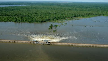 This May 2011 file photo shows Mississippi River water being diverted through the Morganza flood control structure.