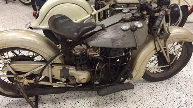 """A greasy, worn-out motorcycle owned by the great Erwin """"Cannonball"""" Baker — in its authentic, unrestored glory."""