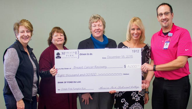 With money raised from the second annual Great Pink Pumpkin Run, Moraine Park Technical College has donated $8,000 to Breast Cancer Recovery. Pictured with the donation are, from left: Breast Cancer Recovery member Helen Denson and executive director Gail Riedasch; Moraine Park President Bonnie Baerwald; and event organizers Brenda Schaefer, Moraine Park social science instructor and service-learning coordinator; and Jeff Stueber, business management instructor.