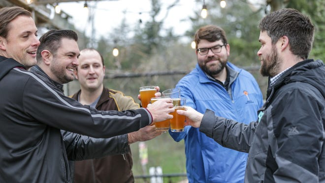 Beer lovers toast the opening of the Spring Blooms  Beer Garden, March 31, 2017. The IMA celebrated a day of openings with an exclusive member reception celebrating Audubon: Drawn to Nature, Paula McCartney: Bird Watching,  and the Spring Blooms  Beer Garden opening.