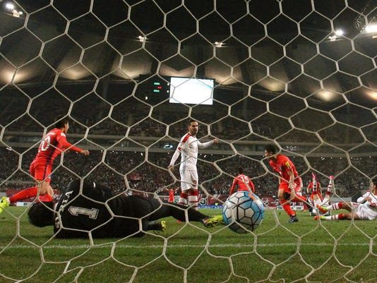Syria's goalkeeper Ibrahim Alma fails to block a goal by South Korea's Hong Jeong-ho (15) during a 2018 Russia World Cup qualifying soccer match between South Korea and Syria at Seoul World Cup Stadium in Seoul, South Korea, Tuesday, March 28, 2017. (AP Photo/Lee Jin-man)