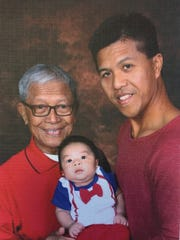 Lawrence Batangan (right) learned how to be a good father to his son Lincoln, from his dad Lorenzo Batangan (left).