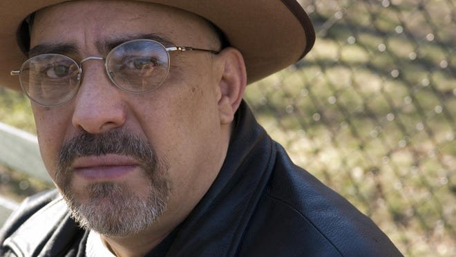 In this Feb. 3, 2007, file photo, Pat DiNizio of Smithereens poses for a photograph in New York. DiNizio, lead singer and songwriter of the New Jersey rock band died at age 62. The band announced on Facebook that DiNizio died Tuesday, Dec. 12, 2017.