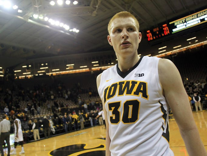 Iowa's Aaron White walks off the court following the