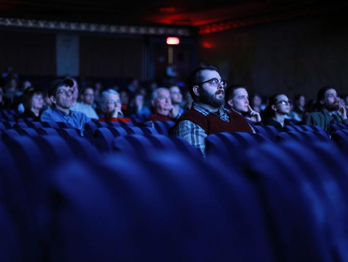 People watch a short film during the Freep Film Festival