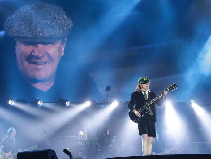 Lead guitarist Angus Young performs with AC/DC during