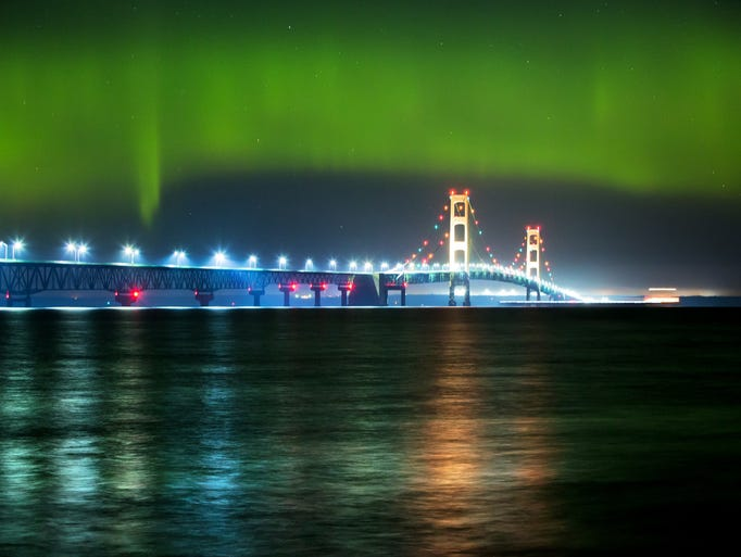 An auroral substorm over the Mackinac Bridge. Skywatchers