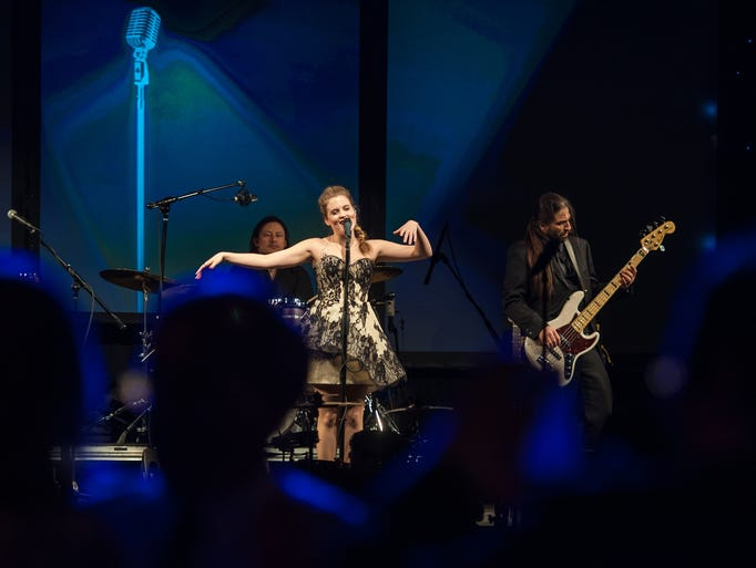 Valerie Broussard sings during the Inaugural Ball for