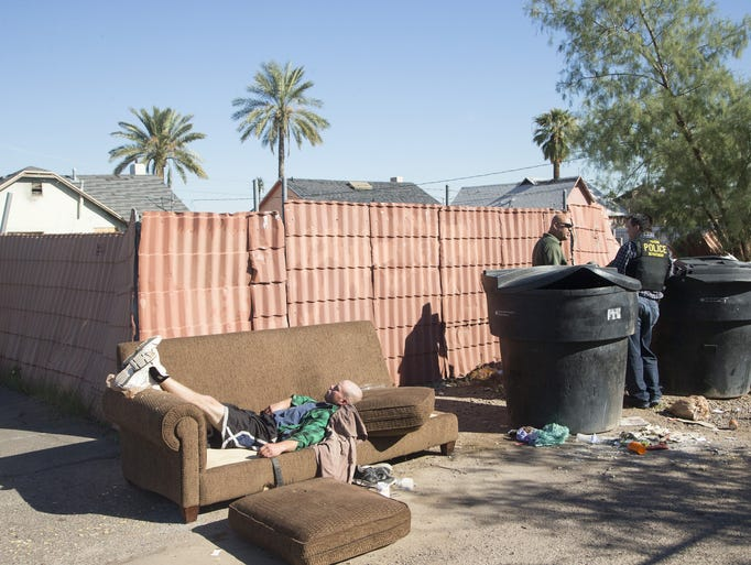 Michael Ambler, 34, sleeps in the alley in downtown